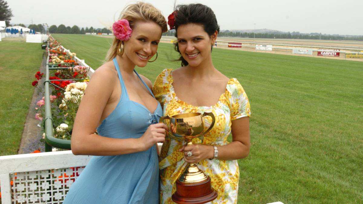 Sarita Stell and Danielle Atkin from Model Behavior brave the wind at Dowling Forrest with the Ballarat Cup in 2006.