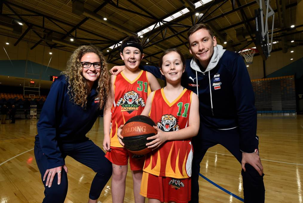 Homegrown Ballarat Rush and Miners players Amelia Jarvis and Sam Short with young Celtic Tigers players Jackson Guthridge, 11, and Stella Quon, 10, at the Ballarat Sports and Events Centre official opening. Picture: Adam Trafford