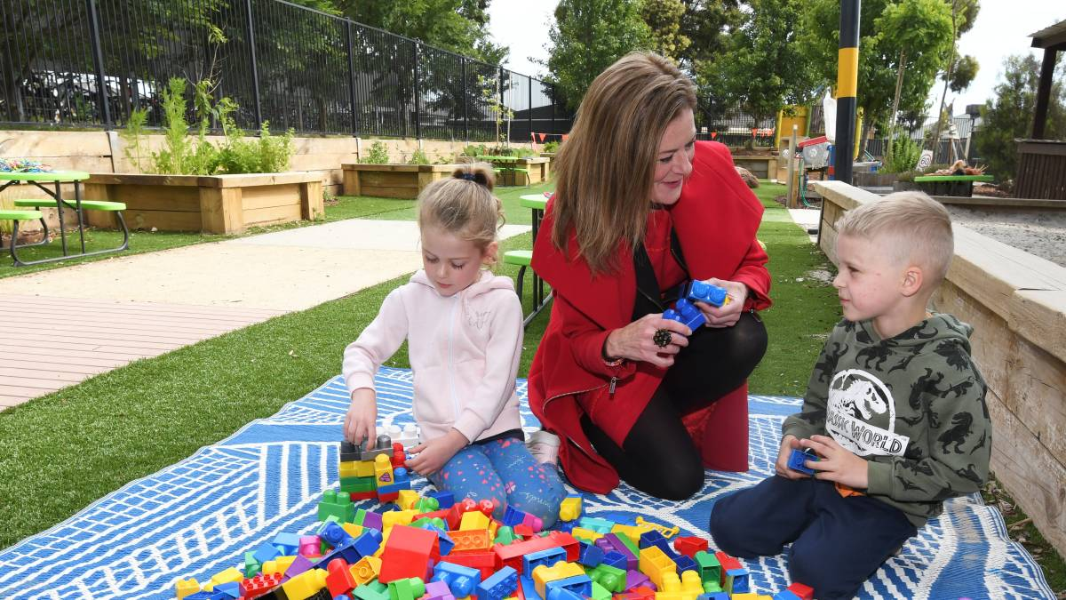 FUN: Parliamentary secretary for early childhood Sonya Kilkenny with Abbey (left) and Riley. Picture: Lachlan Bence.