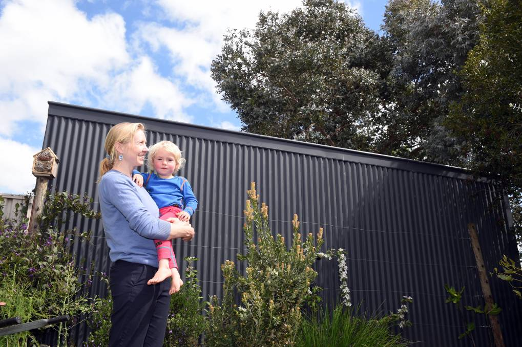 TREE CHANGE: Sophie Ellis and her son Max enjoy the canopy that remains in place over their backyard. Photo: Kate Healy.