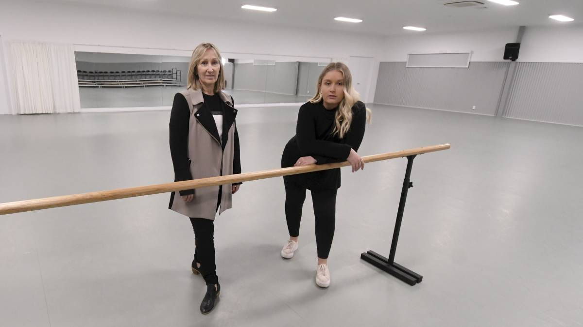 HARD TIMES: Anita Coutts and Leah Delaland inside the empty dance studio. Picture: Lachlan Bence