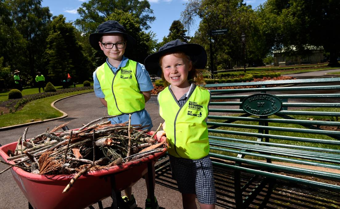 HELPERS: Mount Pleasant Primary School Jaxon and Lily and their grade 1/2 classmates helped clean up the Botanic Gardens. Picture: Adam Trafford