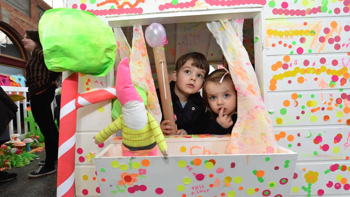 Sam and Maddie Werne enjoying the cubby house at the Rug Up Festival.