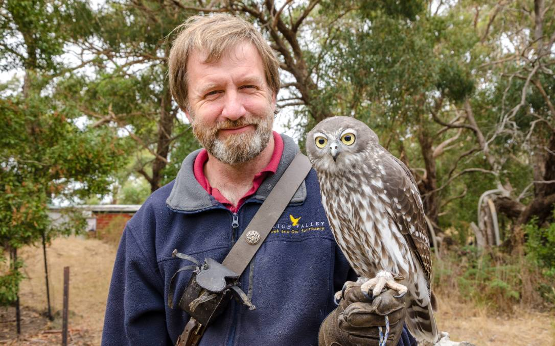 BIRDMAN: Martin Scuffins with Skeksi the barking owl at his property and raptor sanctuary just outside of Ballarat. Picture: Victoria Stone-Meadows.